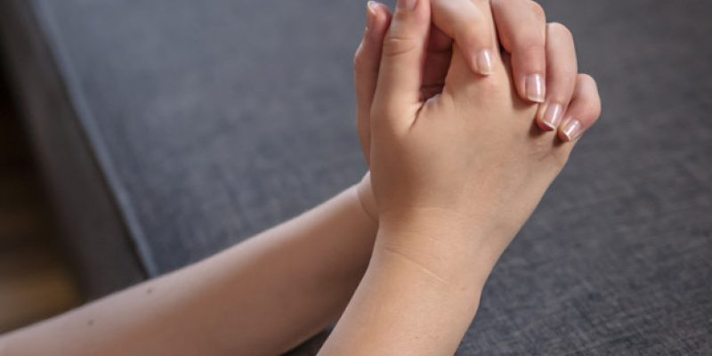 Praying woman hands. woman is praying in bedroom. Unrecognizable woman praying, hands clasped together. Pray in the Morning , Woman praying with hands together